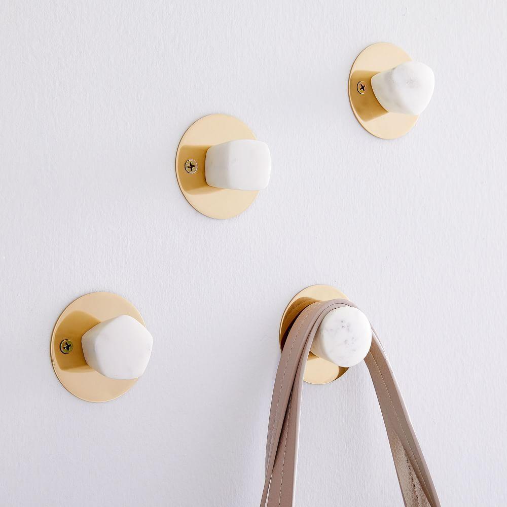 Marble Coat Hooks by Way of Switzerland: Remodelista |Marble Wall Hooks