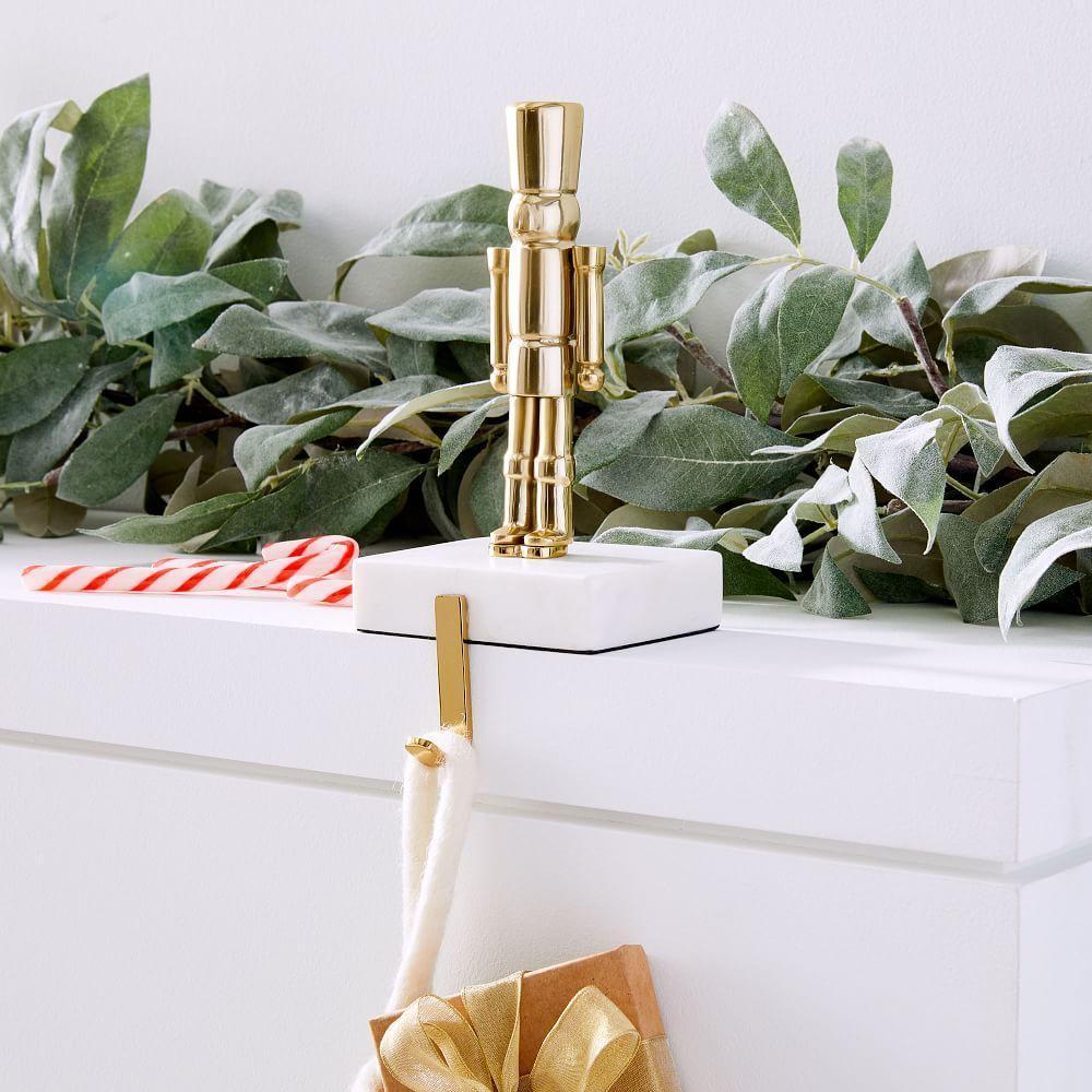 Brass + Marble Nutcracker Stocking Holder